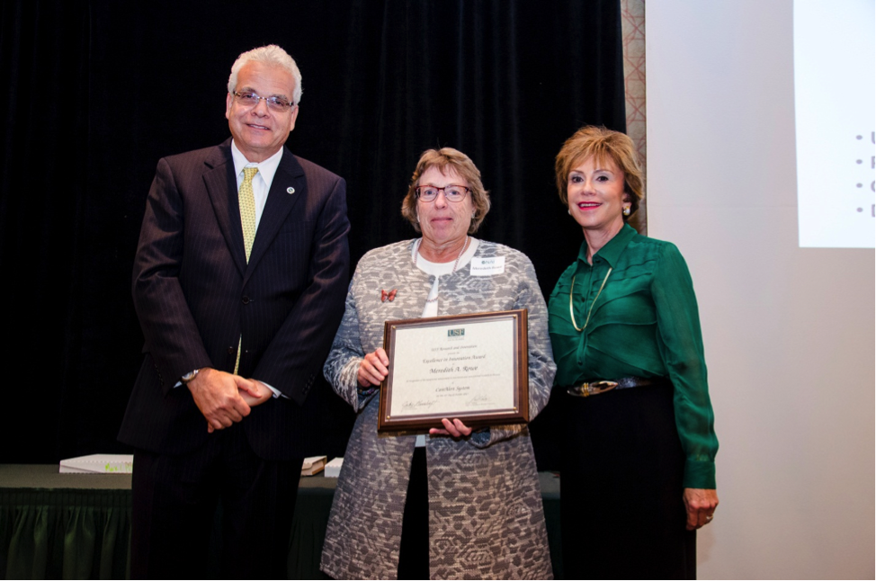 Meredeth Rowe receives her award (Photo: Aimee Blodgett).